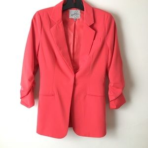 Coral blazer with ruched sleeves